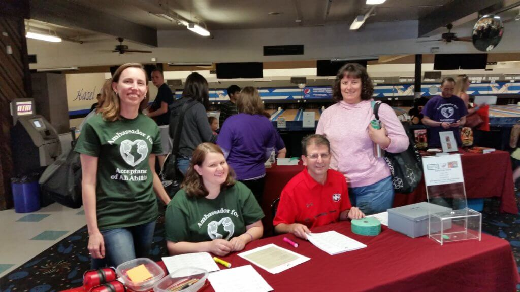 Autism Empowerment Ambassadors of Autism Acceptance helping at check-in