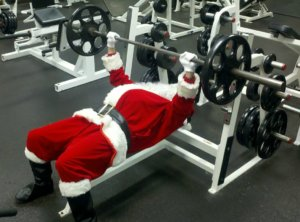 Santa working out on weights